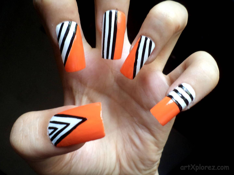 Orange Nails With Black And White Duo Stripes Nail Art Design