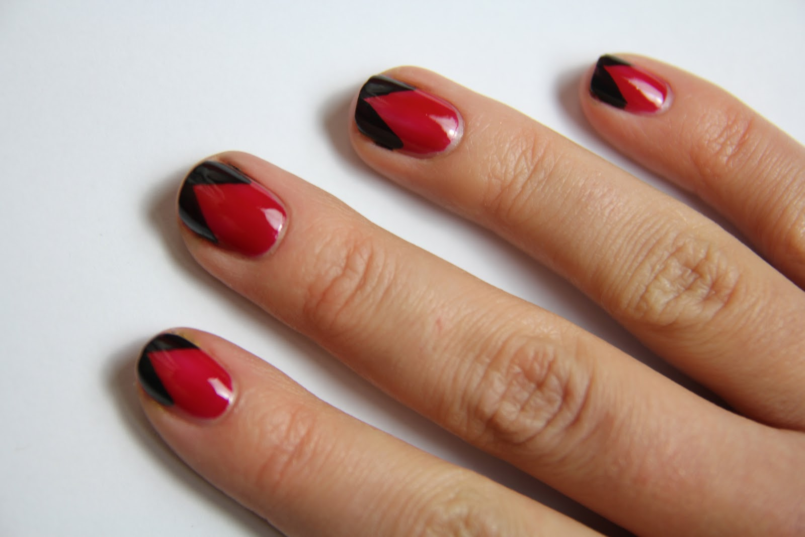 Red Nails With Black Chevron Tip Design Idea