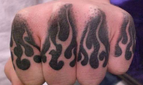 Lone Wolf Knuckle Tattoo