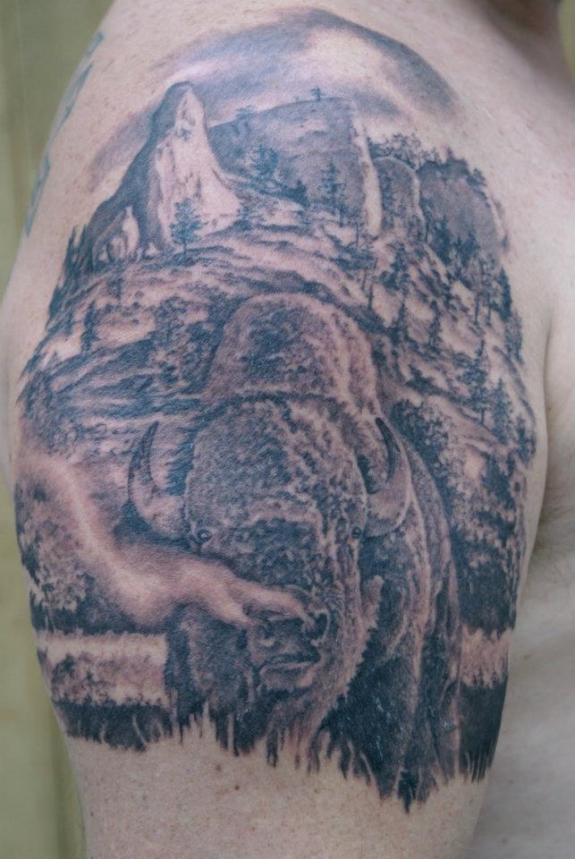 Black Ink Buffalo Tattoo On Man Right Shoulder