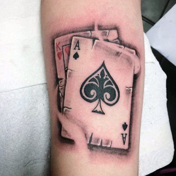 King Of Hearts And Ace Of Spades Cards Tattoo On Arm