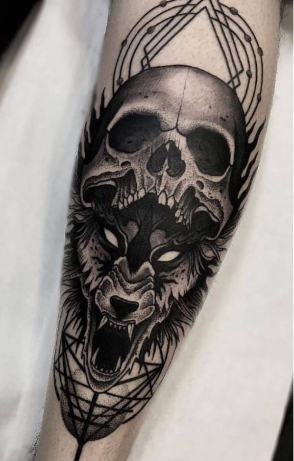 wolf and skull tattoo forearm