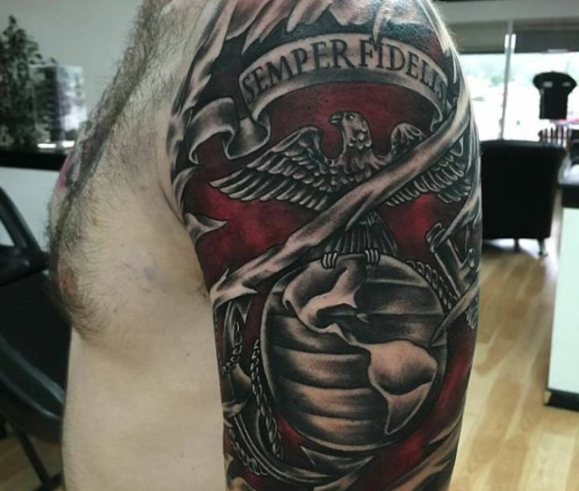 Black And Red Shaded Globe Eagle And Anchor Tattoo On Left Upper Arm