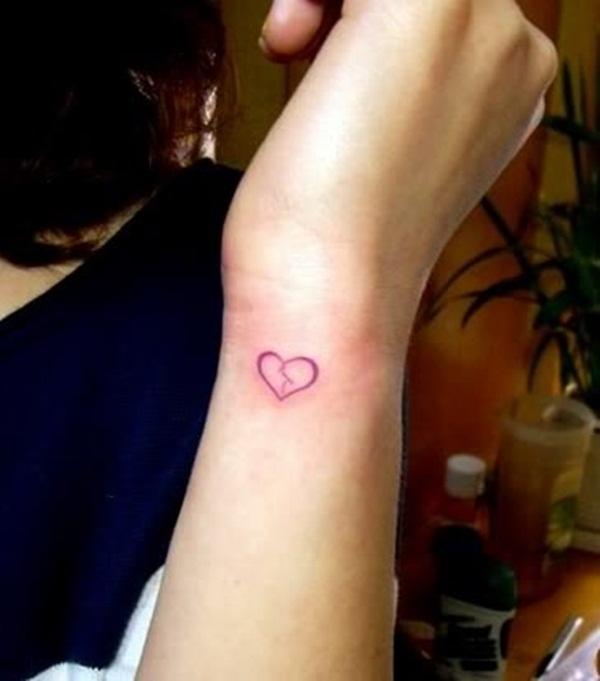 Small Red Broken Heart Tattoo