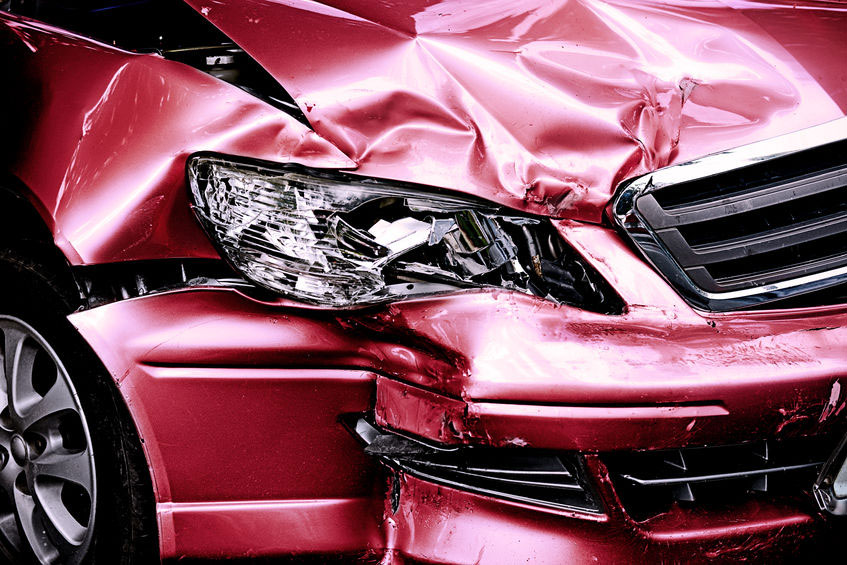 close up of red car, damaged in auto accident