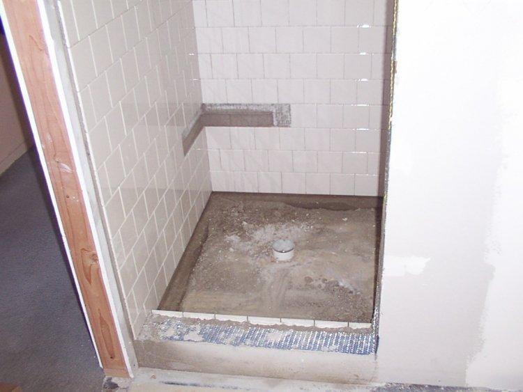 Shower pan weep holes