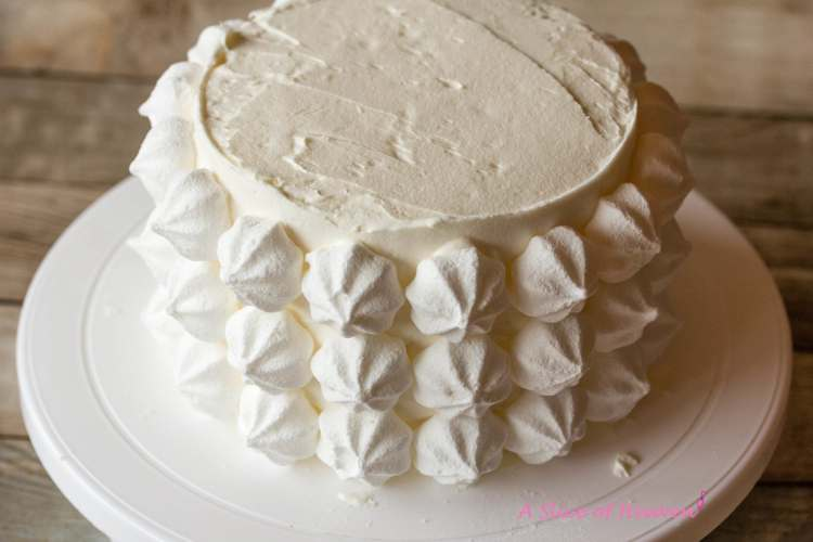 Meringues on the side of the cake