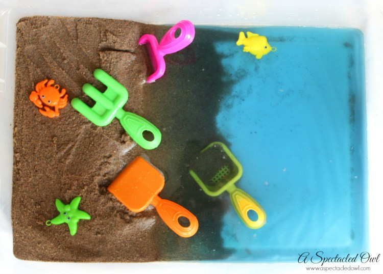 Beach Sensory Bin - If you're not able to go to the beach, why not bring the beach to you? This Beach Sensory Bin is fun to make and lots of fun to play with! The shovels and beach toys can easily be found at your local dollar store and the sand is inexpensive too! The bin in the picture used approximately 25 pounds of play sand. I purchased a 50-pound bag of play sand at Lowe's in the garden section for under $5. Have fun and let your imagination run wild!