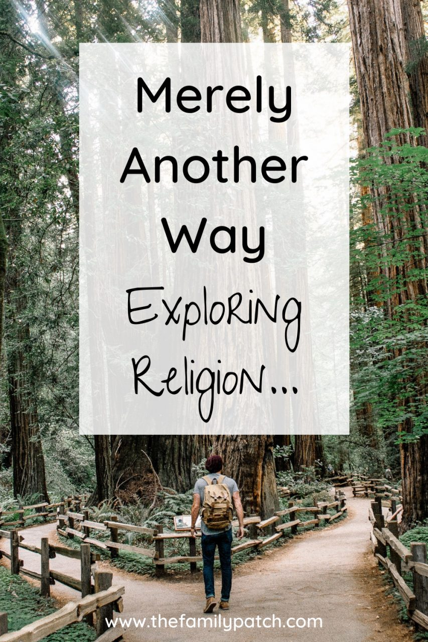 """Image of a man with a backpack standing at a fork in the path around some large redwood trees. The words """"Merely Another Way. Exploring Religion"""" are overlaid on the image."""