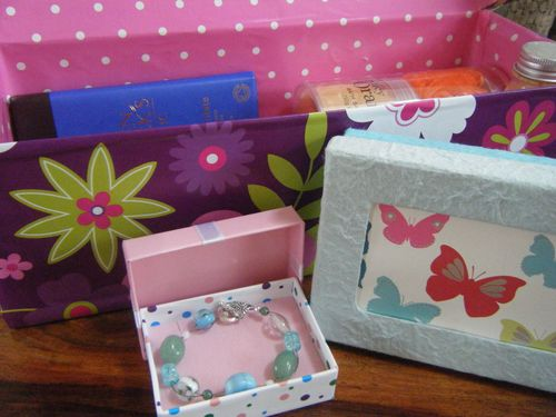 A selection of finished DIY paper covered boxes - including a jewellery box, memory box and beauty hamper gift box