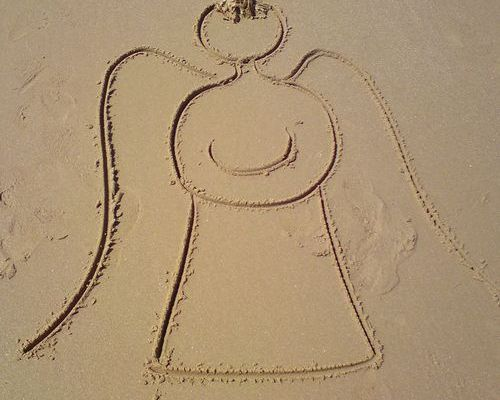 Angel drawn in the sand - sand writing