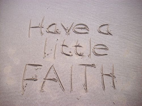 Have A Little Faith message drawn in the sand