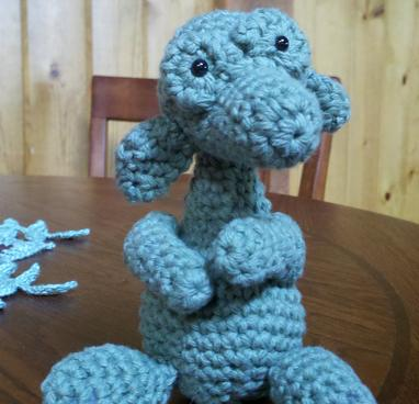 Blue crochet dinosaur toy