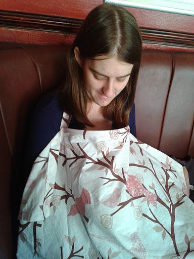 Breastfeeding in public wearing a Nursing cover