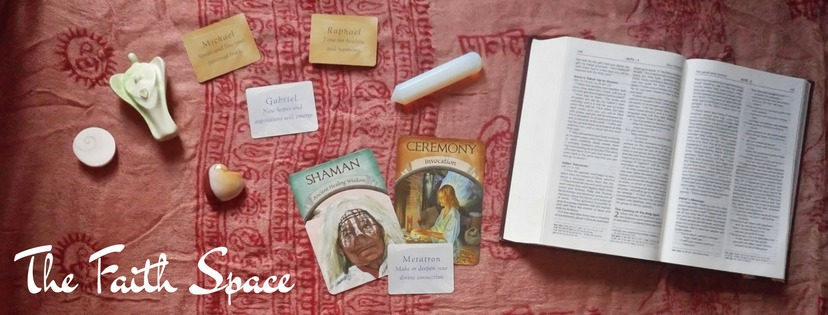 The Faith Space - image of open Bible alongside Oracle Cards and Crystals