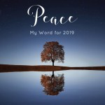 """Image of a tree reflected into a still lake, with the word, """"Peace, my word for the year 2019"""""""