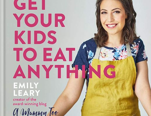 Image of a family cookbook entitled Get Your Kids To Eat Anything. Cover photo shows the author, Emily, wearing a yellow apron and chopping a variety of vegetables.