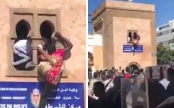 لحظة محاولة انتحار إفريقية من فوق مقر مركز الشرطة