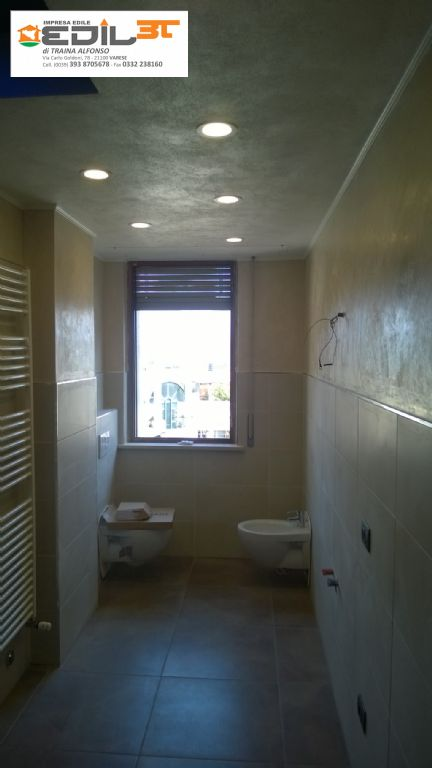 Rifacimento bagno con doccia in muratura e abbassamento in
