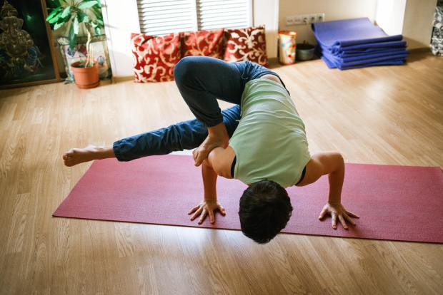 a person doing yoga indoors