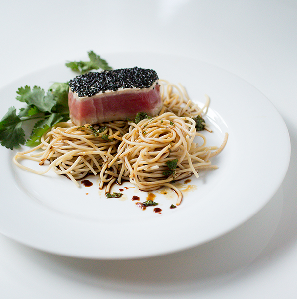 seared tuna with coriander mint noodles a stack of dishes