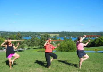 Rabbi Debra Kolodny | As the Spirit Moves Us. Rabbi Debra Practicing Tai Chi Sword Form