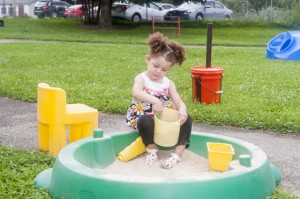 Jeniffer Rivera playing in the sandbox early last summer after attending school.
