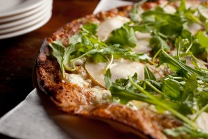 Gigi's Bianca Skizza™ with Coach Farm goat cheese, mozzarella, rosemary, preserved figs, pears and arugula, topped with a drizzle of white truffle oil.