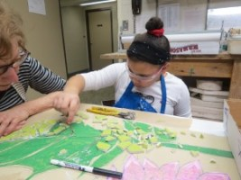 Roberta and Anastasia work on the newest mosaic together.