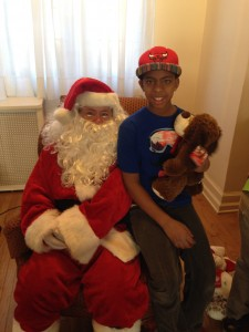 Shawn, a student at the Astor Learning Center, hangs out with Santa this holiday season.