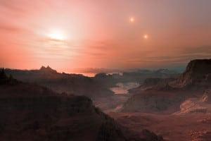 Recreación de un atardecer en el exoplaneta Gliese 667Cc. La estrella más cercana es la enana roja Gliese 667 C, en la derecha aparecen Gliese 667 A y Gliese 667 B, las tres forman parte de un sistema solar triple.