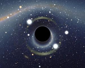 Esta imagen es una simulación de cómo veríamos la Gran Nube de Magallanes si hubiese un agujero negro entre nuestro planeta y la galaxia. Crédito: Alain R./Wikipedia