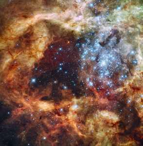 El cúmulo abierto R136, en la Gran Nube de Magallanes. Crédito: NASA, ESA, F. Paresce