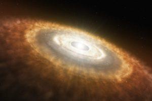 Concepto artístico del inicio del Sistema Solar, en el que la colisión de las partículas en el disco de acreción desembocó en la formación de planetesimales y, eventualmente, planetas.  Crédito: NASA/JPL-Caltech