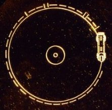 Esta imagen del disco de oro explica cómo se utiliza. Crédito: NASA