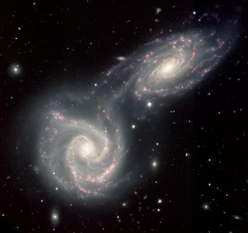NGC 5427 (linksonder) en NGC 5426, oftewel Arp 271