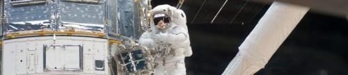 Andre Feustel bezig aan de Hubble