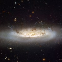 NGC 4522 wordt gestript