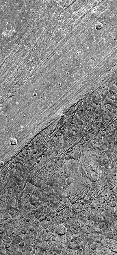 close-up of boundary between a grooved area and dark area on Ganymede