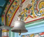 Ringing the bell in temple