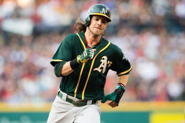 CLEVELAND, OH - JULY 30: Josh Reddick #22 of the Oakland Athletics rounds second on his way to third off a hit by Danny Valencia #26 during the first inning against the Cleveland Indians at Progressive Field on July 30, 2016 in Cleveland, Ohio. (Photo by Jason Miller/Getty Images)