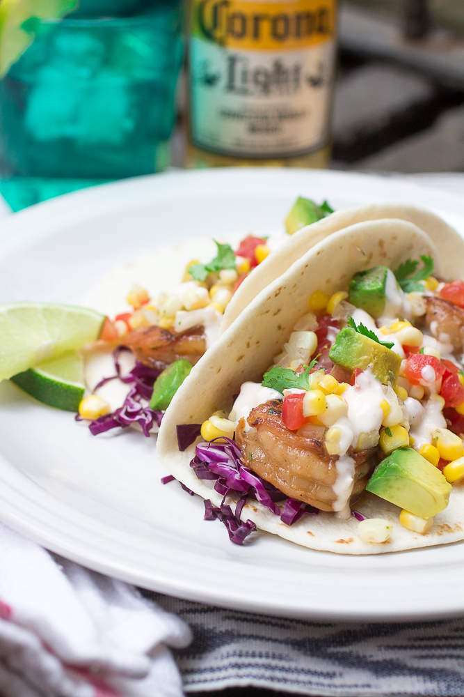 Sweet and Spicy Tequila Shrimp Tacos with Chipotle Lime Crema and Corn Pico