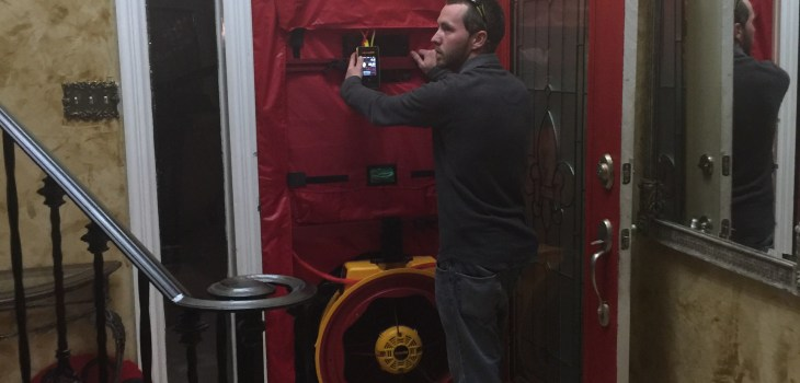 Running a blower door test during energy audit