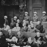 [The defendants at Nuremberg. Credit: National Archives, courtesy of USHMM Photo Archives Copyright: Public Domain]