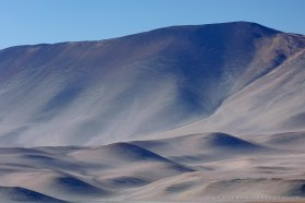 Desert mountain slopes at Salar de Pajonales appear like a painting, Chile
