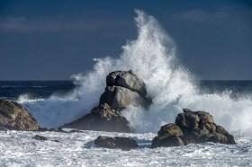Huge waves crashing at the rocky Atacama desert coast