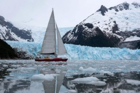 Yacht sailing along the glacier front of Pia fjord, Tierra del Fuego Patagonia