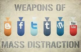 text says weapons of mass distraction. four bombs with the logos of facebook, twitter, wordpress and tumbler