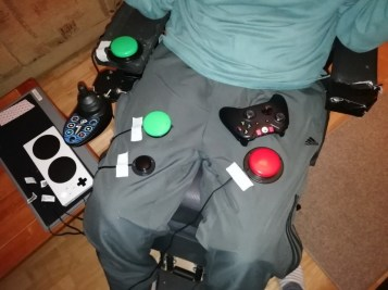 switch setup for FIFA 19. One switch on arm rest, two on right leg, one on left leg and the xbox controller