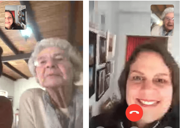 Young lady taking to elderly lady on a video call.